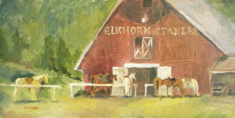 large red barn with horses tied in front