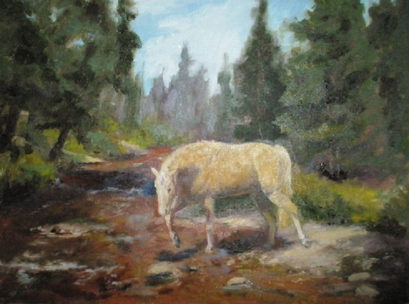 palomino horse in mountain creek